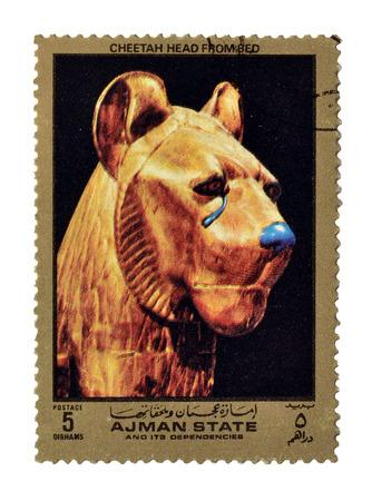 ajman: Cancelled postage stamp printed by Ajman state, that shows Cheetah head, circa 1972.