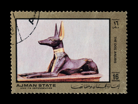 post stamp: Cancelled postage stamp printed by Ajman state, that shows The dog Anubis, circa 1972. Editorial