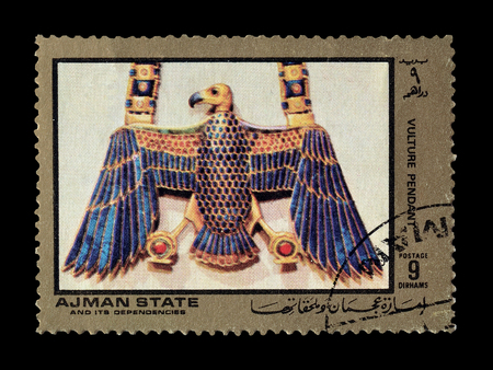 ajman: Cancelled postage stamp printed by Ajman state, that shows vulture pendant, circa 1972. Editorial