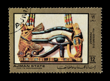 seeing: Cancelled postage stamp printed by Ajman state, that shows All seeing eye pendant, circa 1972.
