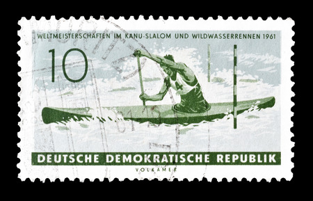 democratic: Cancelled postage stamp printed by German Democratic Republic, that shows Canoe, circa 1961.