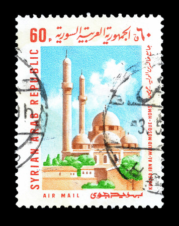 ibn: Cancelled postage stamp printed by Syria, that shows Khaled ibn al Walid Mosque Homs, circa 1969. Editorial