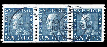 gustaf: Cancelled postage stamps printed by Sweden, that shows portrait of king Gustaf V, circa 1922. Editorial