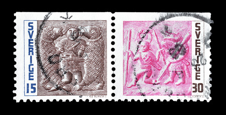 disguised: Cancelled postage stamps printed by Sweden, that show Man fighting two bears and Warrior disguised as wolf pursuing enemy, circa 1967. Editorial