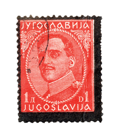 philately: Cancelled postage stamp printed by Yugoslavia, that shows portrait of king Alexander, circa 1934. Editorial