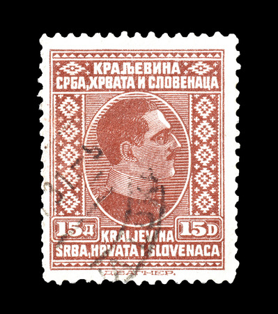 yugoslavia: Cancelled postage stamp printed by Yugoslavia, that shows portrait of king Alexander, circa 1927. Editorial