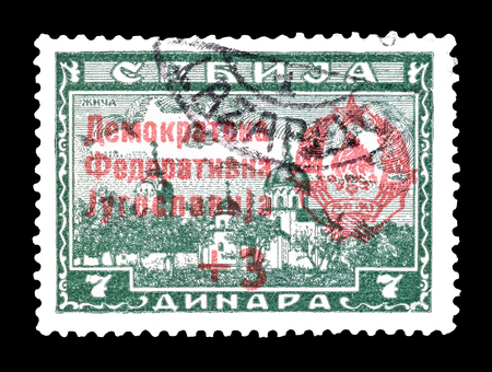 overprint: Cancelled postage stamp printed by Yugoslavia, that shows Overprint on German occupation issue, circa 1945. Editorial