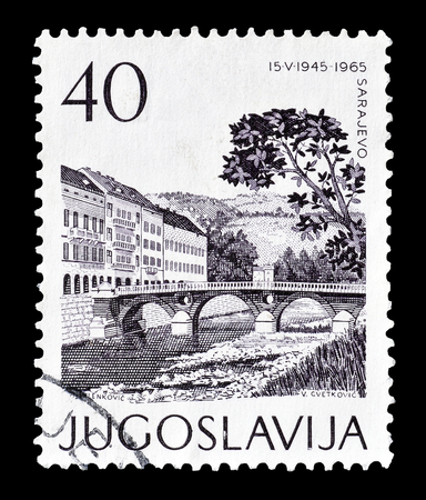 philately: Cancelled postage stamp printed by Yugoslavia, that shows Sarajevo, circa 1965. Editorial