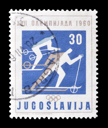 yugoslavia: Cancelled postage stamp printed by Yugoslavia, that shows skiers, circa 1960.