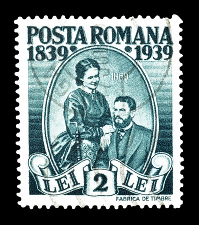 elisabeth: Cancelled postage stamp printed by Romania, that shows King Carl I and Queen Elisabeth, circa 1938.