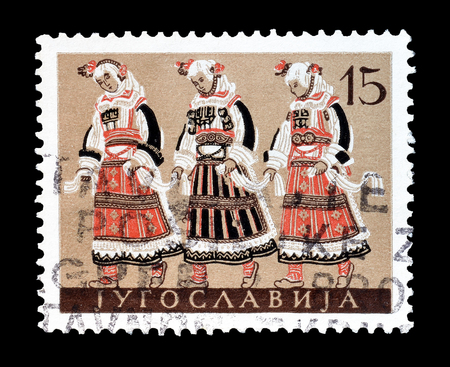 yugoslavia: Cancelled postage stamp printed by Yugoslavia, that shows National costumes of Macedonia, circa 1957. Editorial