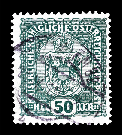 philately: Cancelled postage stamp printed by Austria, that shows Coat of arms, circa 1916.