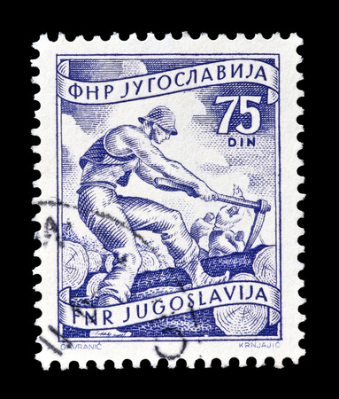 lumbering: Cancelled postage stamp printed by Yugoslavia, that shows lumbering, circa 1952. Editorial