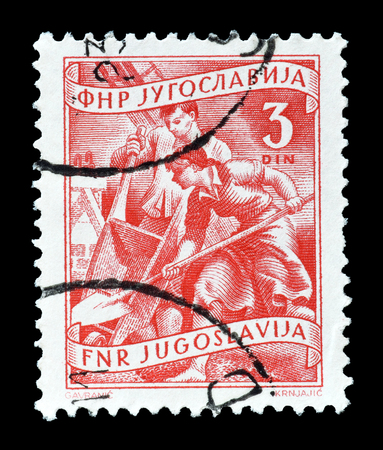 yugoslavia: Cancelled postage stamp printed by Yugoslavia, that shows construction, circa 1950.