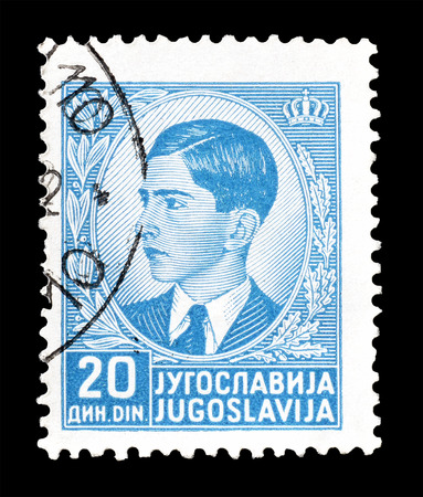 yugoslavia: Cancelled postage stamp printed by Yugoslavia, that shows portrait of king Peter II, circa 1940.