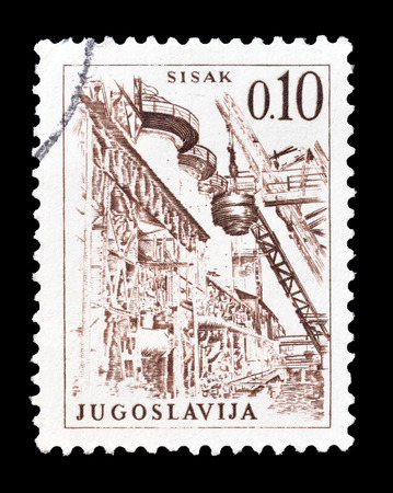 steel works: Cancelled postage stamp printed by Yugoslavia, that shows Sisak steel works, circa 1966.