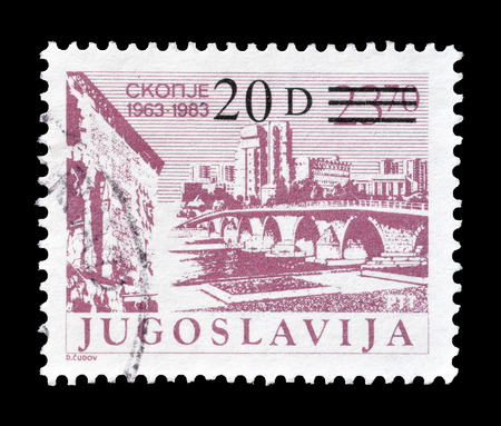 philately: Cancelled postage stamp printed by Yugoslavia, that shows Skopje, circa 1983.
