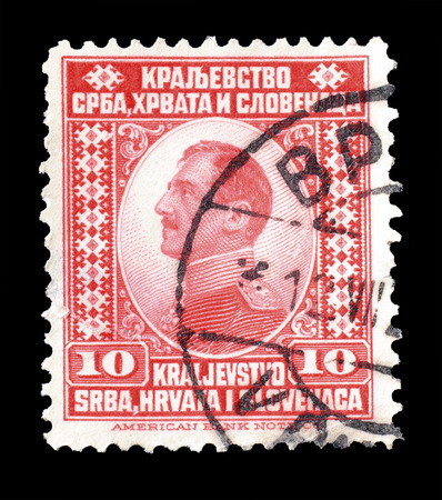 yugoslavia: Cancelled postage stamp printed by Yugoslavia, that shows portrait of king Alexander, circa 1921. Editorial