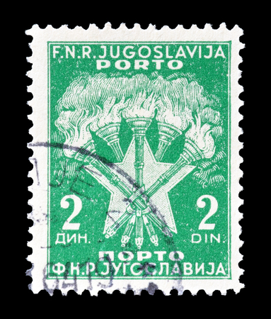 yugoslavia: Cancelled postage stamp printed by Yugoslavia, that shows torches and star, circa 1946. Editorial