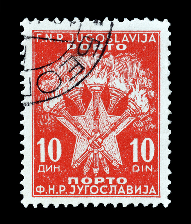 Cancelled postage stamp printed by Yugoslavia, that shows torches and star, circa 1946. Editorial