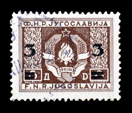 philately: Cancelled postage stamp printed by Yugoslavia, that shows coat of arms, circa 1949. Editorial