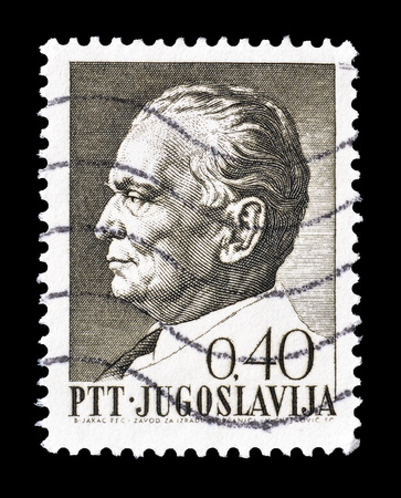 philately: Cancelled postage stamp printed by Yugoslavia, that shows portrait of president Tito, circa 1967.