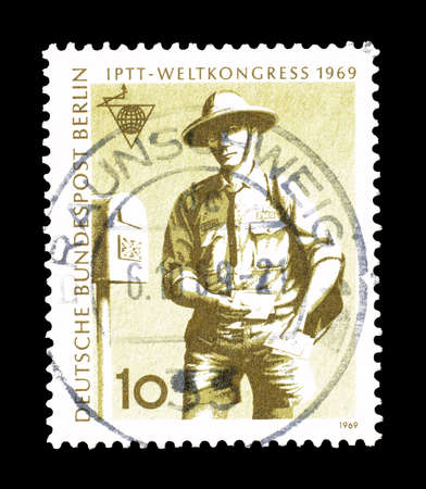 mailmen: Cancelled postage stamp printed by Berlin, that shows Australian postman, circa 1969.