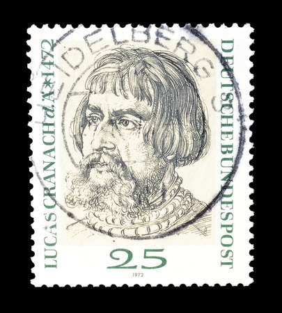 lucas: Cancelled postage stamp printed by Germany, that shows portrait of painter Lucas Cranach, circa 1972.