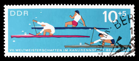 democratic: Cancelled postage stamp printed by German Democratic Republic, that shows canoe race, circa 1966. Editorial