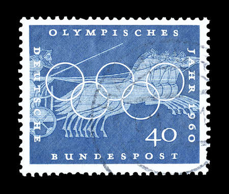olympic rings: Cancelled postage stamp printed by Germany, that shows Chariot race, Greek vase paintings and Olympic rings, circa 1960. Editorial