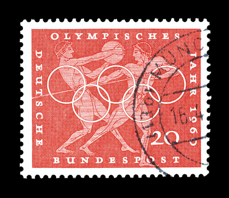 discus: Cancelled postage stamp printed by Germany, that shows Discus and javelin throw, Greek vase paintings and Olympic rings, circa 1960. Editorial
