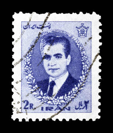 shah: Cancelled postage stamp printed by Iran, that shows portrait of Shah, circa 1966. Editorial