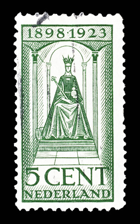 wilhelmina: Cancelled postage stamp printed by Netherlands, that shows queen Wilhelmina, circa 1923.