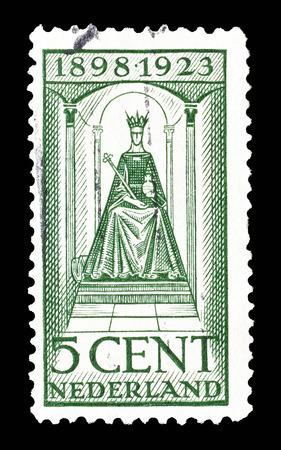 wilhelmina: Cancelled postage stamp printed by Netherlands, that shows queen Wilhelmina, circa 1923.