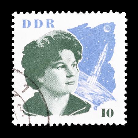 tereshkova: Cancelled postage stamp printed by German Democratic Republic, that shows Valentina Tereshkova and space craft, circa 1963.