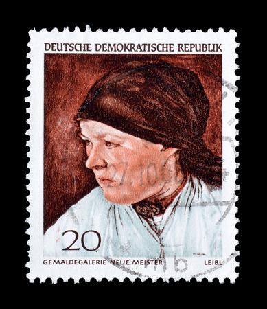 campesino: Cancelado sello impreso por la Rep�blica Democr�tica Alemana, que muestra la mujer campesina de Wilhelm Leibl, alrededor de 1968.