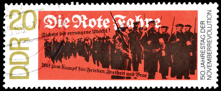 democratic: Cancelled postage stamp printed by German Democratic Republic, that shows workers and soldiers, circa 1968.