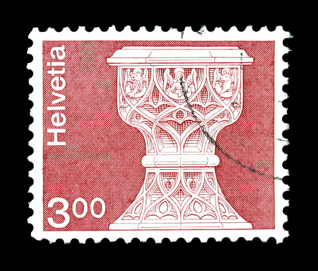 baptismal: Cancelled postage stamp printed by Switzerland, that shows Gothic baptismal font, circa 1979. Editorial