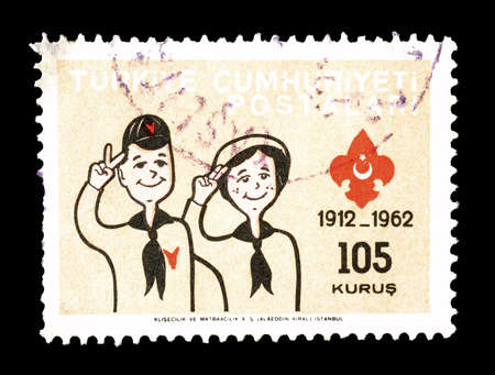 scouts: Cancelled postage stamp printed by Turkey, that shows Scouts saluting, circa 1962.