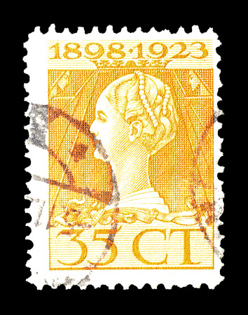 wilhelmina: Cancelled postage stamp printed by Netherlands, that shows portrait of queen Wilhelmina, circa 1923.
