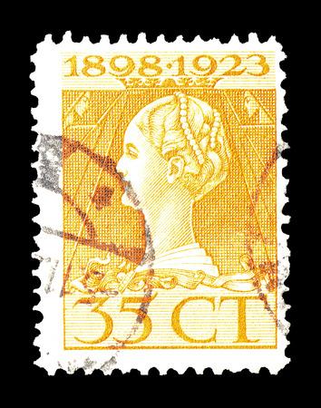 wilhelmina: Cancelled postage stamp printed by Netherlands, that shows portrait of queen Wilhelmina, circa 1923.