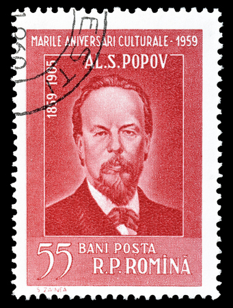 philately: Cancelled postage stamp printed by Romania, that shows portrait of Popov, circa 1959. Editorial