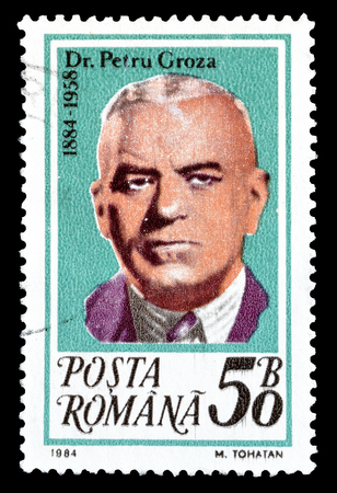 dr: Cancelled postage stamp printed by Romania, that shows Dr Petru Groza, circa 1984.