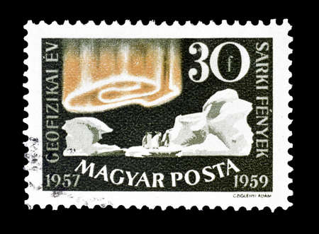 polar light: Cancelled postage stamp printed by Hungary, that shows Polar light,penguins an icebergs, circa 1959.