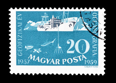 philately: Cancelled postage stamp printed by Hungary, that shows research vessel and iceberg, circa 1959.