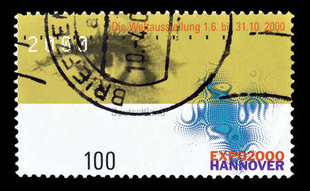 expo: Cancelled postage stamp printed by Germany, that shows Human Eye and EXPO Emblem, circa 2000.