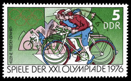 democratic: Cancelled postage stamp printed by German Democratic Republic, that shows cyclists, circa 1976.