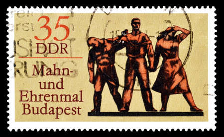 democratic: Cancelled postage stamp printed by German Democratic Republic, that shows Memorial in Budapest, circa 1976.