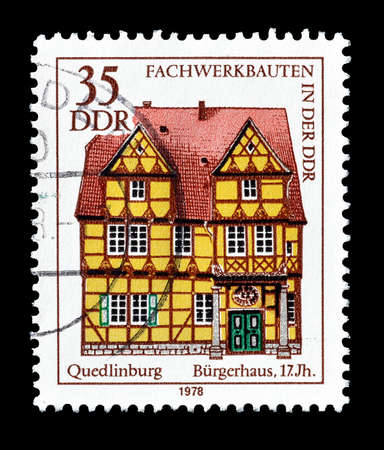 philately: Cancelled postage stamp printed by German Democratic Republic, that shows Quedlinburg Mansion, circa 1978.