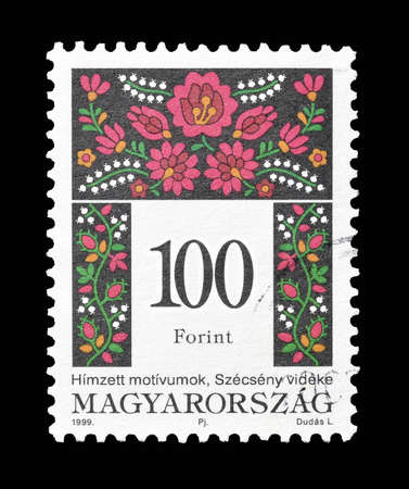 motive: Cancelled postage stamp printed by Hungary, that shows Folk motive, circa 1999.
